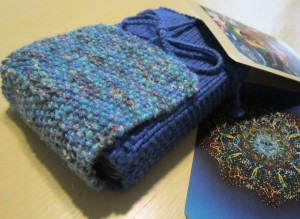 Sally hand-knits bags for Tarot decks of all sizes.